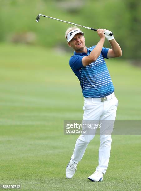 Soren Kjeldsen of Denmark plays his second shot on the par 4 third hole in his match against Rory McIlroy of Northern Ireland during the first round...