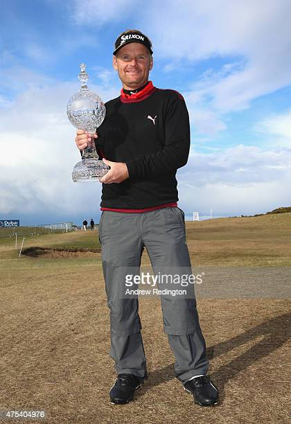 Soren Kjeldsen of Denmark poses with the trophy after his victory in a playoff during the Final Round of the Dubai Duty Free Irish Open Hosted by the...