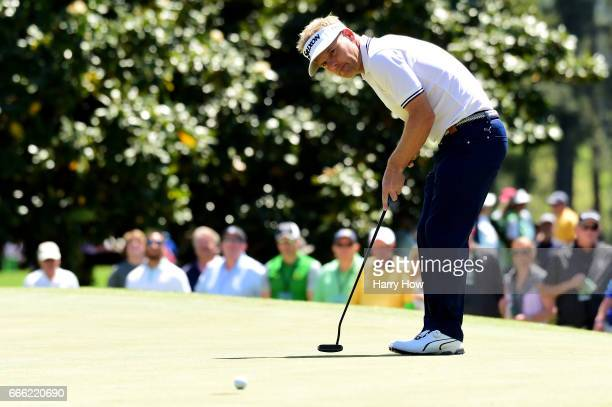 Soren Kjeldsen of Denmark putts for a birdie on the first hole during the third round of the 2017 Masters Tournament at Augusta National Golf Club on...