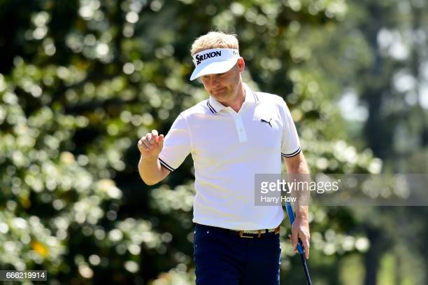 Soren Kjeldsen of Denmark reacts to making a birdie on the first hole during the third round of the 2017 Masters Tournament at Augusta National Golf...