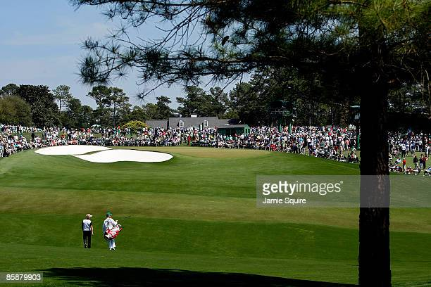 Soren Kjeldsen of Denmark walks to the ninth green with his caddie during the first round of the 2009 Masters Tournament at Augusta National Golf...