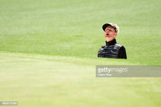 Soren Kjeldsen of Denmark watches his shot from a bunker on the first hole during the second round of the 2017 Masters Tournament at Augusta National...