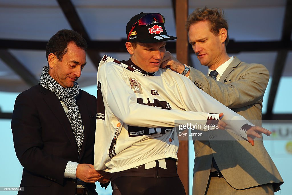 Soren Kragh Andersen of Denmark and Team Giant-Alpecin is helped on with the his best young rider jersey after stage five of the 2016 Tour of Qatar, a 114.5km road stage from Sealine Beach Resort to Doha Corniche, on February 12, 2016 in Doha, Qatar