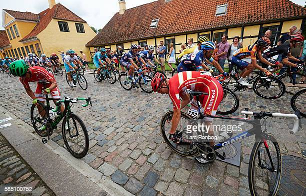Soren Kragh Andersen pushes captain Magnus Cort of Team Postnord Danmark after a puncture near Vallo Slot Castle during stage five at the Postnord...