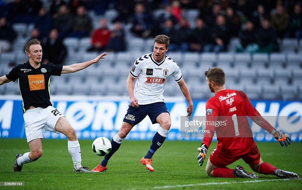 Soren Reese of Viborg FF, Stephan Petersen of AGF Aarhus and Goalkeeper Peter Friis Jensen of Viborg FF compete for the ball during the Danish Alka Superliga match between AGF Aarhus and Viborg FF at Ceres Park on April 29, 2016 in Aarhus, Denmark.