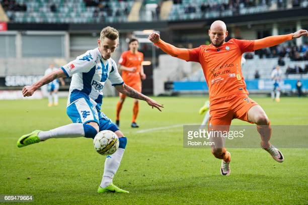 Soren Rieks of IFK Goteborg shoots and Zourab Tsiskaridze tries to stop him during the Allsvenskan match between IFK Goteborg and Athletic FC...