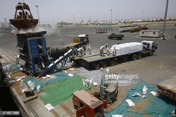 Sorghum grains are sacked after being unloaded from US vessel Liberty Grace hired by the World Food Program to deliver aid food donated from USAID to...