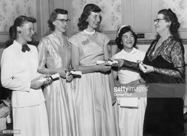 Soroptimist Awards Presented Mrs Nettie J Chinn award chairman of the Soroptimist club of Denver gives cash scholarships to left to right Edith...