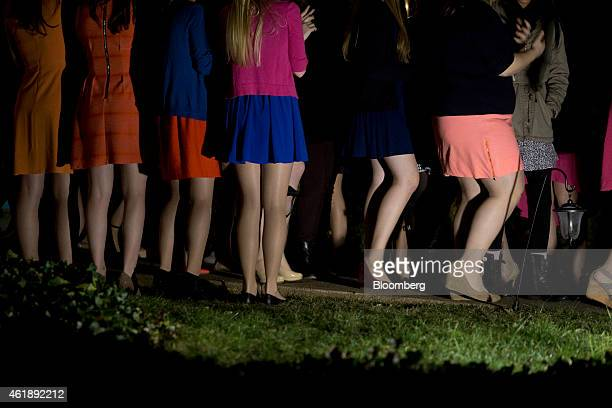 Sorority sisters clap as potential new members leave the house during spring fraternity rush near the University of Virginia campus in...