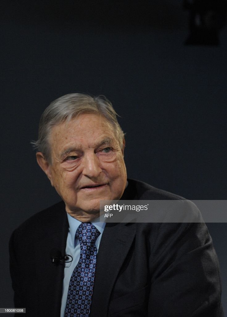 Soros Fund Management Chairman George Soros poses on January 26, 2013, during the World Economic Forum (WEF) meeting in the Swiss resort of Davos. The WEF will see top politicians and business leaders pursue talks on whether they have seen the back of the global financial crisis. AFP PHOTO ERIC PIERMONT