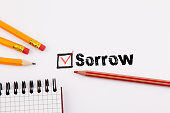 sorrow. Questionnaire with red cross on the white paper