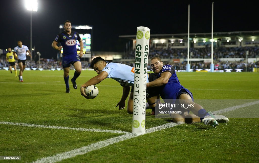Sosaia Feki of the Sharks is tackled by Brenko Lee of the Bulldogs short of the try line during the round 12 NRL match between the Cronulla Sharks and the Canterbury Bulldogs at Southern Cross Group Stadium on May 27, 2017 in Sydney, Australia.
