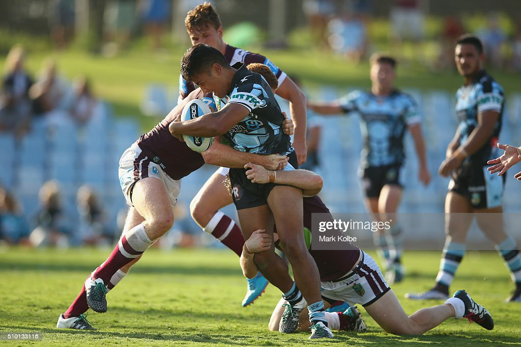 Sosaia Feki of the Sharks is tackled during the NRL Trial match between the Cronulla Sharks and the Manly Sea Eagles at Remondis Stadium on February 14, 2016 in Sydney, Australia.