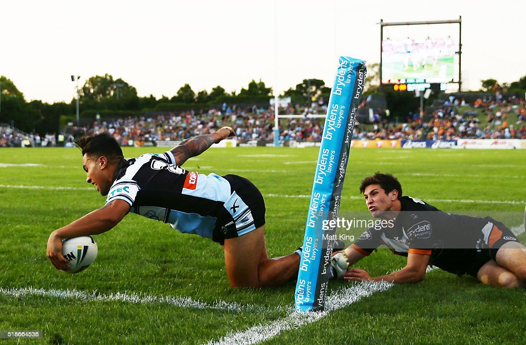 Sosaia Feki of the Sharks scores a try during the round five NRL match between the Wests Tigers and the Cronulla Sharks at Campbelltown Sports...
