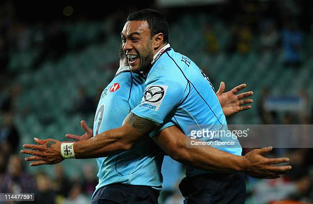 Sosene Anesi of the Waratahs celebrates scoring a try with team mate Tatafu PolotaNau during the round 14 Super Rugby match between the Waratahs and...