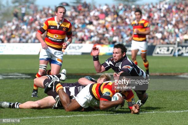 Sosene Anesi of Waikato beats Jason Shoemark and Danny Lee of Hawkes Bay to score a try in the Air New Zealand Cup quaterfinal between the Hawkes Bay...