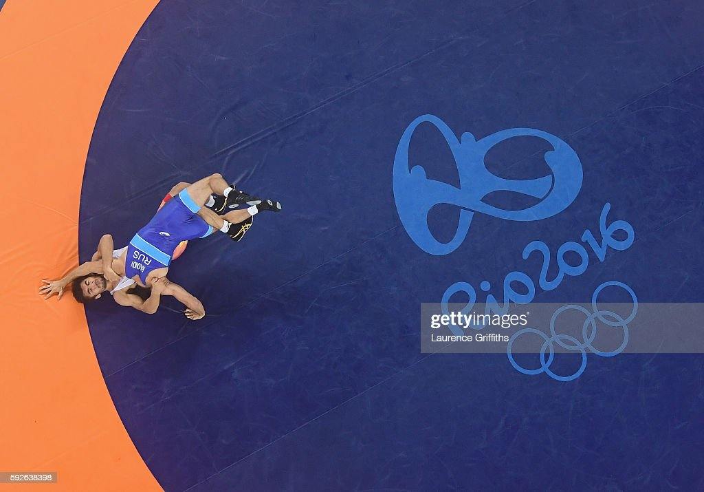 Soslan Romanov of Russia defeats Ikhtiyor Navruzov of Uzbekistan during the Mens Freestyle 65kg Wrestling at Carioca Arena 2 on August 21, 2016 in Rio de Janeiro, Brazil.