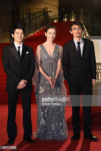 Sosuke Ikematsu Rie Miyazawa and Daihachi Yoshida of Japan arrive at the opening ceremony during the 27th Tokyo International Film Festival at...