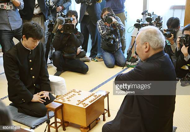 Sota Fujii a 14yearold professional shogi player takes on Hifumi Kato in the Ryuo tournament in Tokyo on Dec 24 2016 Fujii who became the youngest...