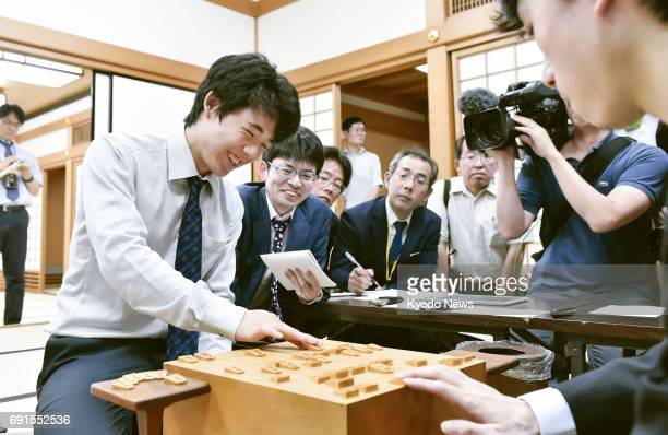 Sota Fujii at 14 the youngest professional player of shogi or Japanese chess reviews a match against Shingo Sawada in Osaka on June 2 after extending...