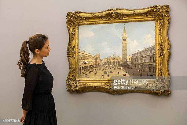 Sotheby's auction house employee views 'Venice a view of Piazza San Marco looking east towards the Basilica' by Canaletto on November 28 2014 in...