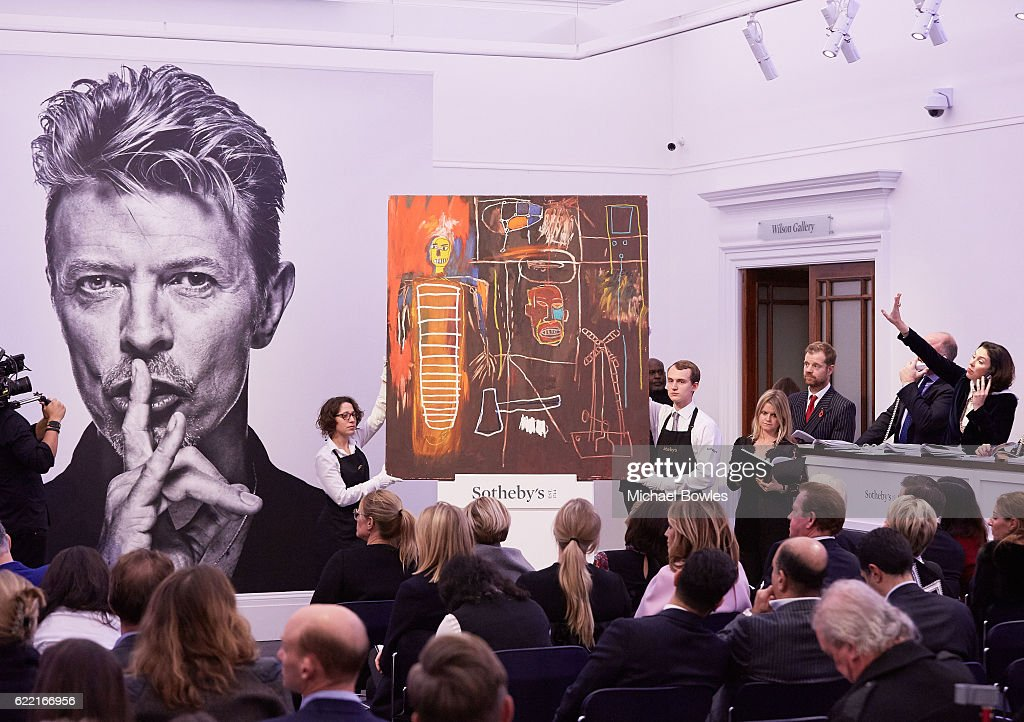 Sotheby's auctioneer Oliver Barker fields bids for Peter Lanyon's 'Witness' which sold for a record £797,000 at the white-glove sale of David Bowie's personal art collection on November 10, 2016 in London, England. Tonight's top lot was Jean-Michel Basquiat's Air Power, which more than doubled its estimate to sell for £7,093,000.