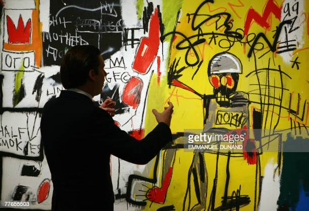 Sotheby's contemporary art specialist Alexander Rotter talks about the painting 'Untitled ' by US artist JeanMichel Basquiat during a preview of...