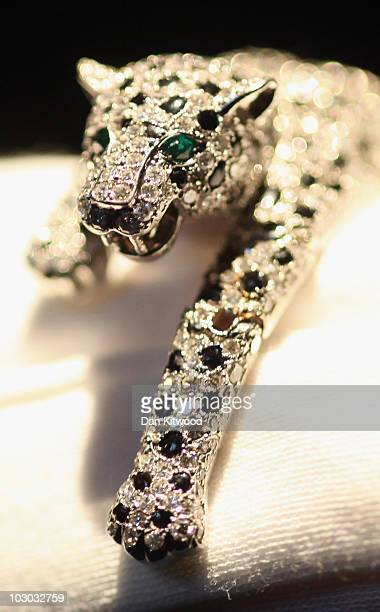 Sotheby's employee holds an onyx and diamond panther bracelet designed and made by Cartier in 1952 during a preview at Sotheby's Auction House on...
