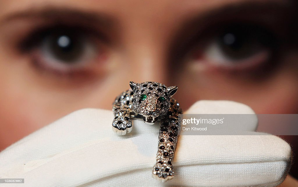 A Sotheby's employee holds an onyx and diamond panther bracelet designed and made by Cartier in 1952, during a preview at Sotheby's Auction House on July 22, 2010 in London, England. This piece of jewellery is one of a collection going on sale including a selection of iconic jewels belonging to the Duchess of Windsor. The pieces are estimated to fetch in the region of £3 million GBP at the sale, which takes place at Sothebys Auction house on November 30, 2010 in London.
