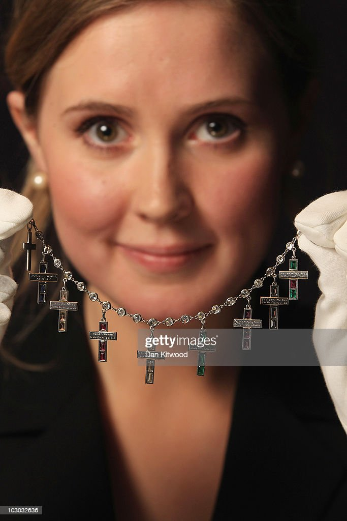 A Sotheby's employee holds up a diamond bracelet created by Cartier in 1935, during a preview at Sotheby's Auction House on July 22, 2010 in London, England. This piece of jewellery is one of a collection going on sale including a selection of iconic jewels belonging to the Duchess of Windsor. The pieces are estimated to fetch in the region of £3 million GBP at the sale, which takes place at Sothebys Auction house on November 30, 2010 in London.