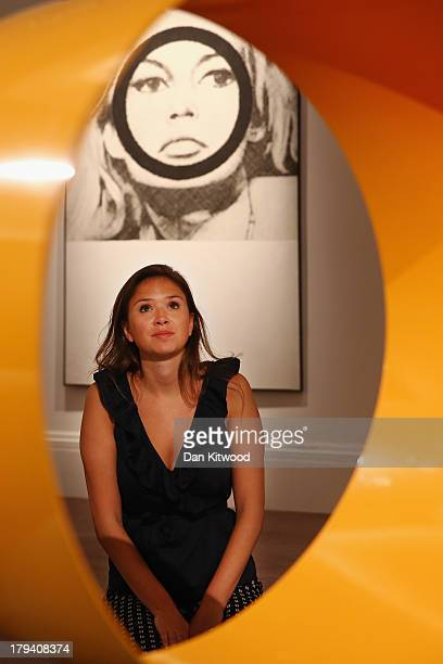 Sotheby's employee poses in front of a piece of work entitled 'Bridget Bardot' by Gerald Laing at Sotheby's auction house on September 3 2013 in...