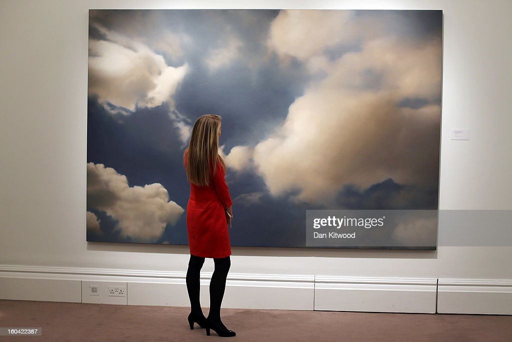 A Sotheby's employee stands in front of a painting by Gerhard Richter entitled 'Wolke, (Cloud),' 1932, on January 31, 2013 in London, England. The piece makes up a selection of works by artists including Monet, Miro, Picasso and Richter and is estimated to sell for between 7-9 Million GBP at auction in the 'Contemporary Art' evening sale at Sotheby's auction house on February 12, 2013.