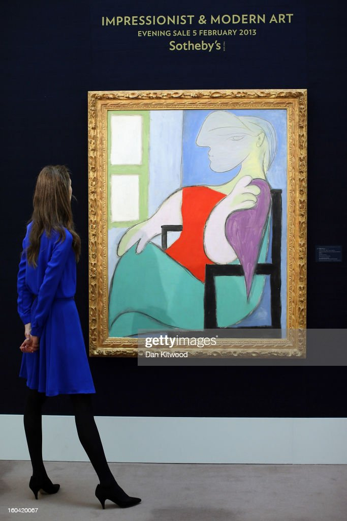A Sotheby's employee stands in front of a painting by Pablo Picasso entitled 'Femme assise pres d' une fenetre,' 1932, on January 31, 2013 in London, England. The piece makes up a selection of works by artists including Monet, Miro, Picasso and Richter and is estimated to sell for between 25-35 Million GBP at auction in the 'Impressionist and Modern Art' evening sale at Sotheby's auction house on February 5, 2013.
