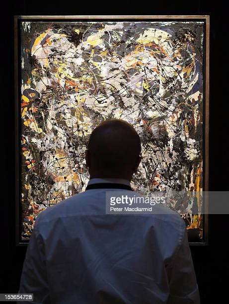 Sotheby's employee stands in front of Jackson Pollock's 'Number 4 1951' on October 8 2012 in London England Estimated at $2535 million the work forms...