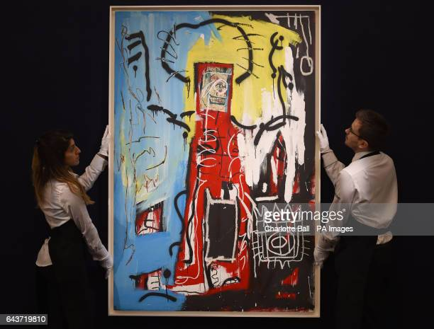 Sotheby's employees adjust Untitled painted in 1982 by JeanMichel Basquiat which is estimated to fetch pound14000 18000 at auction as part of their...