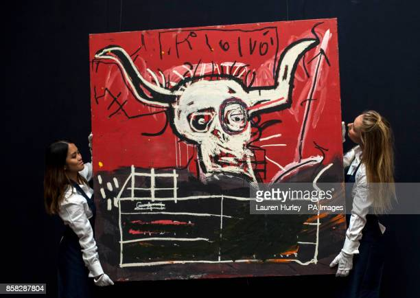 Sotheby's employees hold JeanMichel Basquiat's Cabra 19811982 during a photo call for highlights from forthcoming sales of contemporary and...