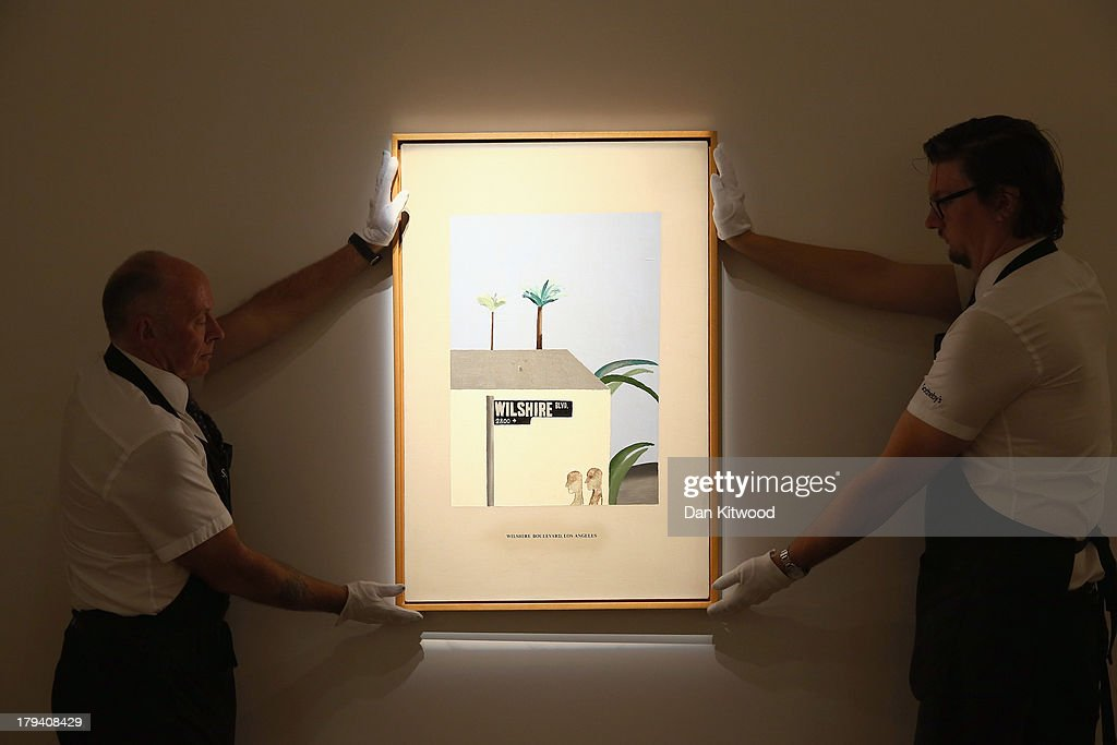 Sotheby's employees pose with a piece of work entitled 'Wilshire Boulevard' by David Hockney at Sotheby's auction house on September 3, 2013 in London, England. The piece makes up part of 'The New Situation' exhibition, comprising of 1960's British Art including paintings by David Hockney and Bridget Riley. The exhibition runs at the auction house until September 11.
