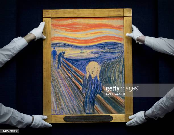 Sotheby's employees pose with Norwegian artist Edvard Munch's 1895 pastel on board version of 'The Scream' at Sotheby's auction house in central...