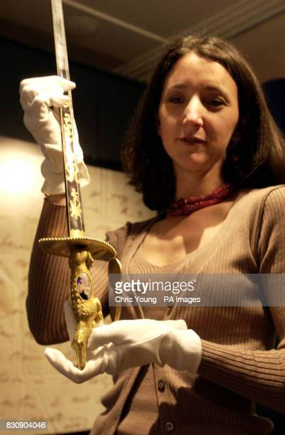 Sotheby's expert Helen Griffiths holds Nelson's Nile Sword The Sword which was presented to those Royal Navy Captains whose ships took part in the...