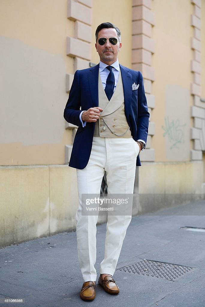 Sotheby's France president Alexander Kraft is seen wearing Cifonelli jacket and pants and Tod's shoes before Tod's show on June 22 2014 in Milan Italy