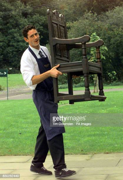 Sotheby's porter Stewart Wright carries Bonnie Prince Charlie's Chair which goes on sale at Sotheby's in West Sussex The oak armchair in which the...