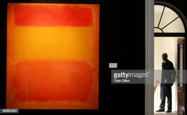 Sotheby's security guard stands at a gallery entrace where Mark Rothko's 'Orange Red Yellow' is hung on April 14 2008 in London England The artwork...