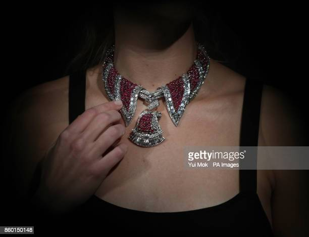 A Sotheby's staff member wearing a ruby and diamond pendant necklace and brooches dating from the 1950s and estimated at pound120000180000 during a...