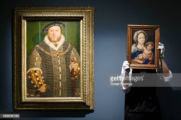 Sotheby's technician holds a depiction of the Madonna and Child by Jan Grossaert circa 1520s1530s next to one of the greatest images of King Henry...