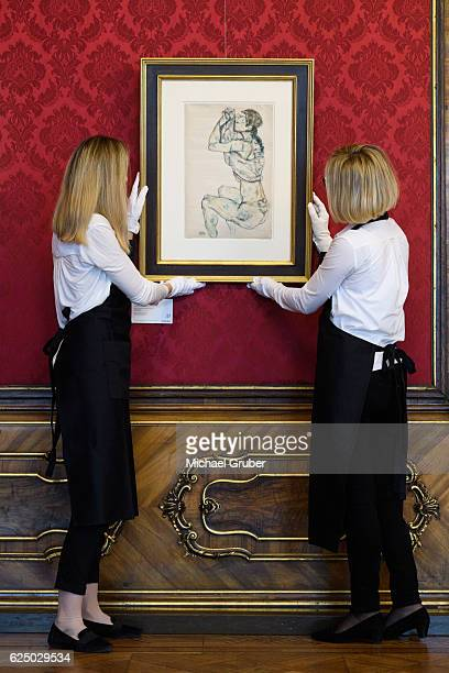 Sothebys technicians adjust Egon Schieles 'Weiblicher Akt mit Hochgeschobenem Hemd' in 'A glimpse into Austria's private collections' an exhibition...