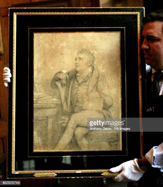 A Sotherby's technician shows off Lot 99 a portrait drawing of Samuel Taylor Coleridge signed and dated G Dawe 1812 which is expected to fetch...