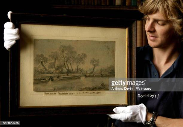 A Sotherby's technician showsoff Lot 75 Barges on the River Stour at Flatford by John Constable expected to fetch between 4060 at the Chanter's House...
