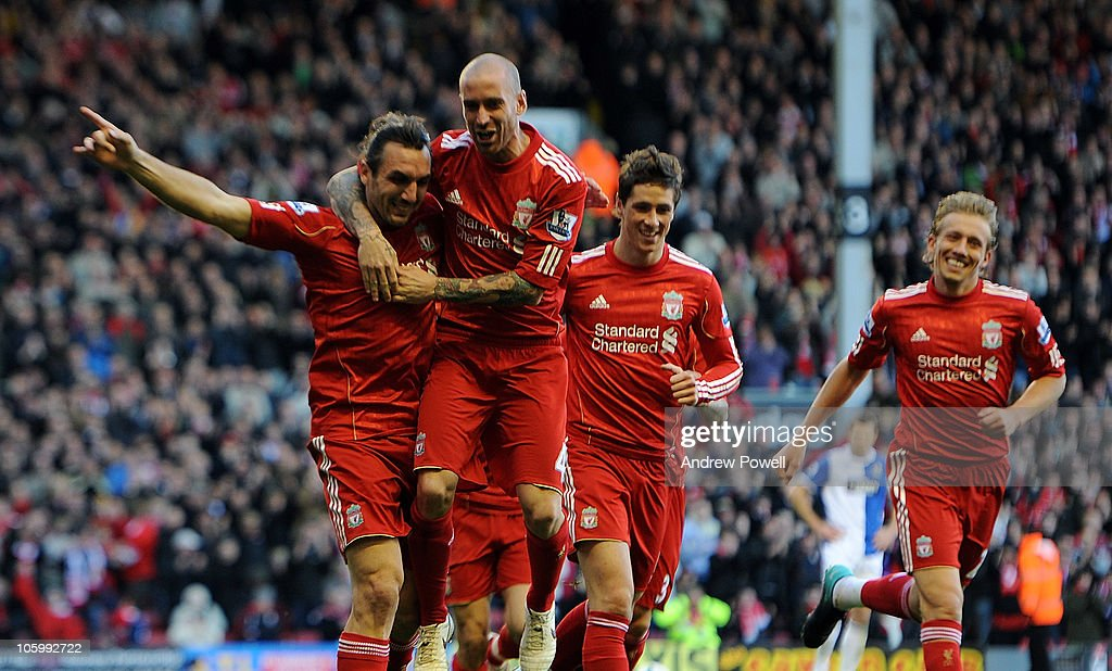 <a gi-track='captionPersonalityLinkClicked' href=/galleries/search?phrase=Sotirios+Kyrgiakos&family=editorial&specificpeople=3940791 ng-click='$event.stopPropagation()'>Sotirios Kyrgiakos</a> of Liverpool celebrates his goal during the Barclays premier league match between Liverpool and Blackburn Rovers at Anfield on October 24, 2010 in Liverpool, England.