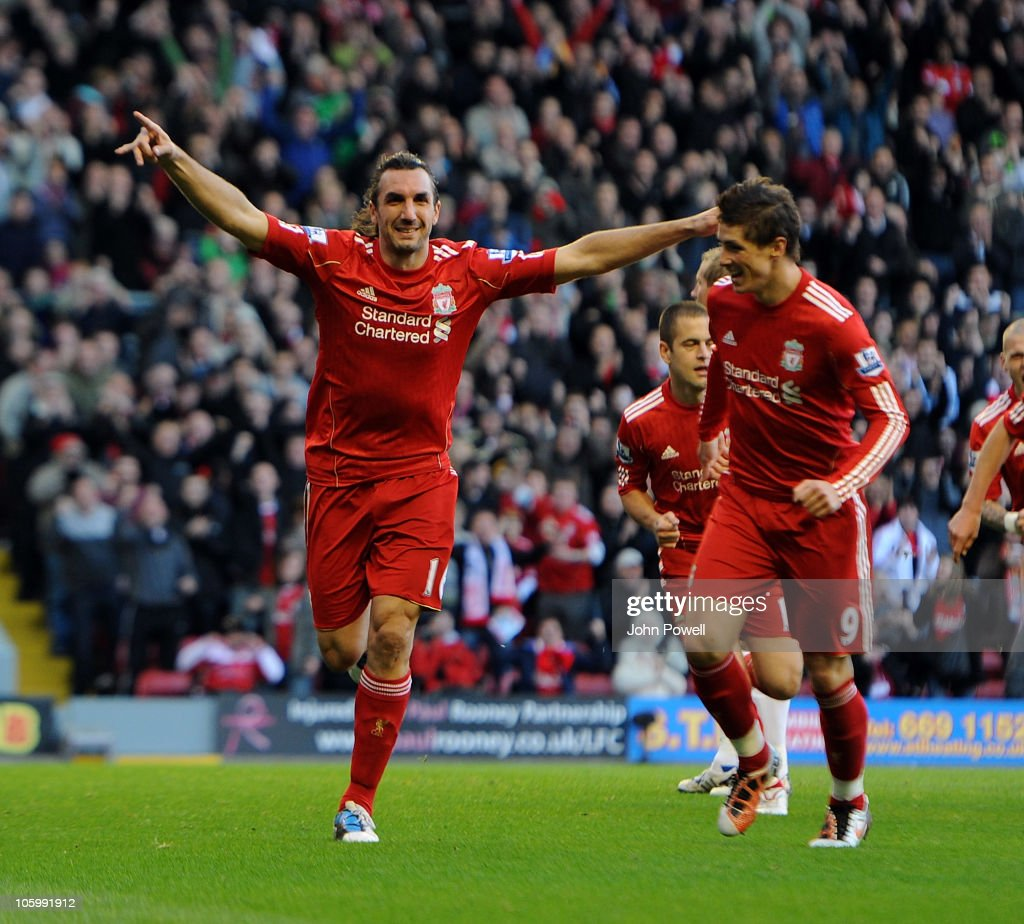 <a gi-track='captionPersonalityLinkClicked' href=/galleries/search?phrase=Sotirios+Kyrgiakos&family=editorial&specificpeople=3940791 ng-click='$event.stopPropagation()'>Sotirios Kyrgiakos</a> of Liverpool celebrates his goal with <a gi-track='captionPersonalityLinkClicked' href=/galleries/search?phrase=Fernando+Torres&family=editorial&specificpeople=194755 ng-click='$event.stopPropagation()'>Fernando Torres</a> during the Barclays premier league match between Liverpool and Blackburn Rovers at Anfield on October 24, 2010 in Liverpool, England.