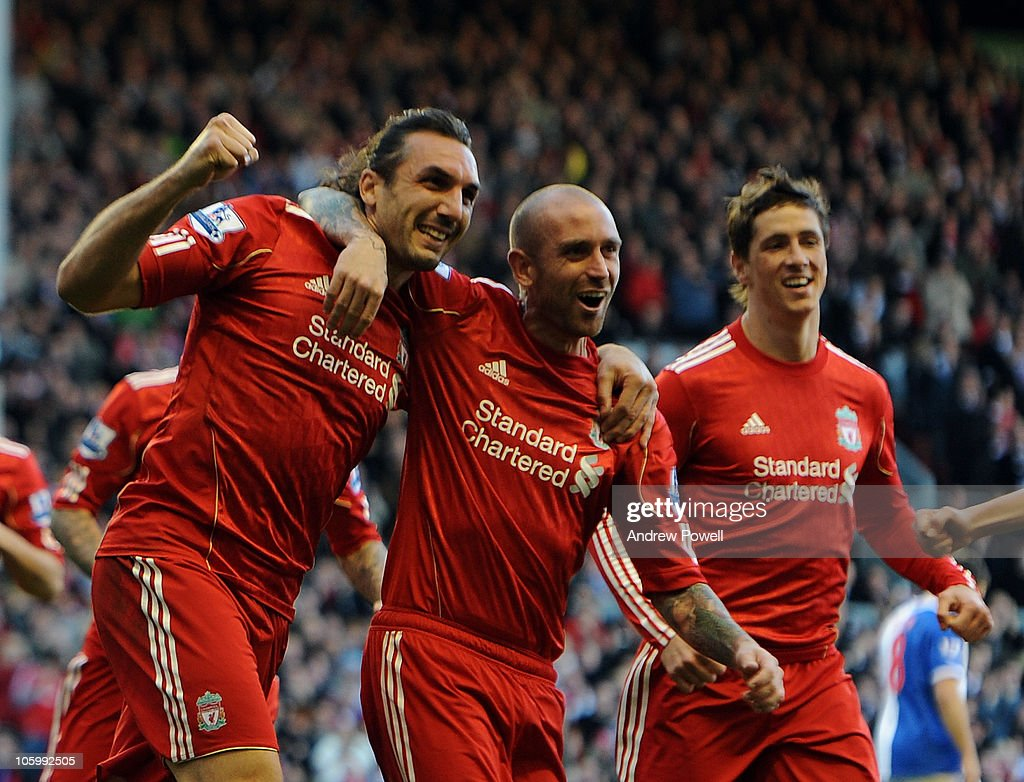<a gi-track='captionPersonalityLinkClicked' href=/galleries/search?phrase=Sotirios+Kyrgiakos&family=editorial&specificpeople=3940791 ng-click='$event.stopPropagation()'>Sotirios Kyrgiakos</a> of Liverpool celebrates his goal with <a gi-track='captionPersonalityLinkClicked' href=/galleries/search?phrase=Raul+Meireles&family=editorial&specificpeople=605369 ng-click='$event.stopPropagation()'>Raul Meireles</a> and <a gi-track='captionPersonalityLinkClicked' href=/galleries/search?phrase=Fernando+Torres&family=editorial&specificpeople=194755 ng-click='$event.stopPropagation()'>Fernando Torres</a> during the Barclays premier league match between Liverpool and Blackburn Rovers at Anfield on October 24, 2010 in Liverpool, England.